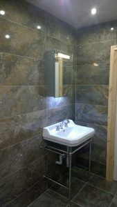 small bathroom basin with integrated towel rail
